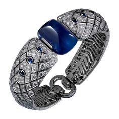 High Jewelry bracelet High Jewelry <br />Cartier Royal <br />headband/bracelets, 18K white gold, one 45.83 carat cabochon-cut sapphire from Ceylon, sapphires, rock crystal, diamonds. The headband can be worn as a bracelet.
