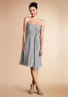 Donna Morgan Stunning chiffon dress with a ruched sweetheart bodice that twists and flows into the whimsical full skirt.