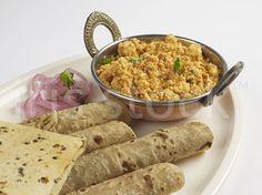 fulko served with keemo paneerji bhajji papar and kachumbo