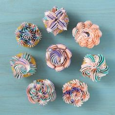 Commonly used to create drop flowers, the large 1E decorating tip can also be used to make amazing shells, stars and more.  With this collection of 8 Ways to Decorate Cupcakes Using Tip 1E, you'll learn how to use this tip to make elegant and fun designs that will make your treats pop!  Prep your decorating bag with a collection of icing colors to get the unique looks shown here.