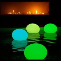 Balloons with glowsticks to make pool lanterns!