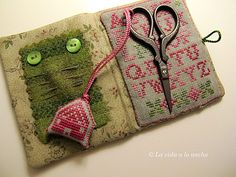 photo - makes me think of more of a lovely sewing kit than a needle case, if the scissors holder were stitched on. Lovely.