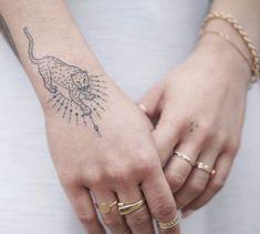 How gorgeous is this minimal wild cat tattoo? How gorgeous is this minimal wild cat tattoo? Hand Tattoos, Body Art Tattoos, New Tattoos, Cool Tattoos, Tatoos, Pretty Tattoos, Unique Tattoos, Beautiful Tattoos, Small Tattoos