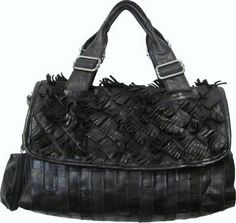 The Nino leather handbag from Amerileather is made from recycled leather, styled with unique angel hair strands of leather. Not only is it flirty, this bag is also environmentally friendly. Color option: Black Construction: Top grain lambskin Entry: Top flap zip main compartment Hardware: Attractive and durable silver hardware Lining: Satin lining Handles: Dual handles, adjustable/ detachable leather shoulder strap Includes bonus coin purse Exterior pockets: One (1) rear zippered pocket…