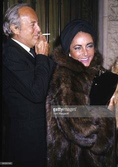 Elizabeth Taylor and Dr. Lou Scarrone leaving his eastside town house.