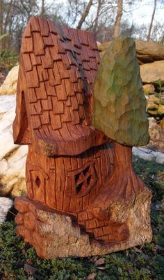 Bark Carving Whimsical Houses | tall house full small cottonwood house
