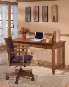 Ashley Cross Island H319-44 Signature Design Dark Oak Home Office Large Leg Desk - Dark Oak Home Office Large Leg Desk With this mission styling comes to life in the rich colored oak and hardwood. Complemented further by these deep color drawer and door handles