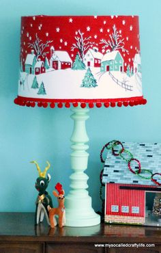 DIY:  How to Cover a Lampshade - using a vintage Christmas tablecloth, matching trim and hot glue - via My So Called Crafty Life