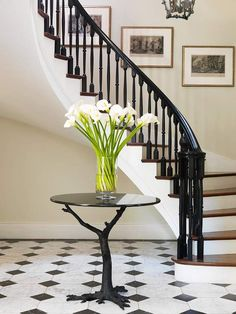 Every part of this--black, brown, and white stairs, the marble floor, and the wall and trim colors.