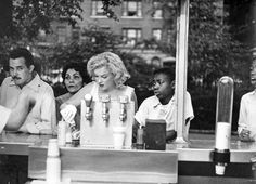 Marilyn Monroe Grabbing A Nosh In Central Park Just Off Of Fifth Avenue & West 110th Street, NYC, 1957. (Photo By Sam Shaw.)