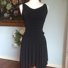 Pretty black dress Another stunning black dress. Elegantly drapes. Asymmetrical on bottom. Shapley fitted waist. The straps have been adjusted to fit a bit smaller to have it not be real low cut. They can be easily removed to put back to normal. They have a loose stitching on them.   Size small 2/4  I.N. San Francisco  Retail $75 I.N. San Francisco Dresses Asymmetrical