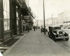 View looking up the sidewalk in front of 1323 South Broadway, 14 April 1932. Missouri History Museum