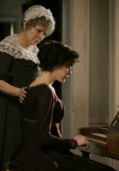 Julie Walters as Mrs. Austen and Anne Hathaway as Jane Austen in Becoming Jane (2007).