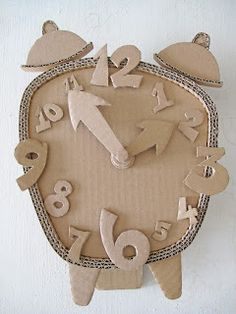 Cardboard Clock DIY Make a Cardboard Clock and let your children decorate diy ideas with cardboardEnjoy this list of creative cardboard crafts, and make your own creation. Do not worry about whether you are wasting anything, because cardboard c Cardboard Sculpture, Cardboard Toys, Cardboard Furniture, Cardboard Crafts Kids, Cardboard Playhouse, Kids Crafts, Arts And Crafts, Decor Crafts, Karton Design
