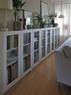 Love this! Perfect for a small room because they are so narrow. :) BILLY bookcases with GRYTNÄS glass doors | IKEA