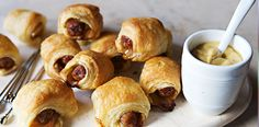 Piglets en Croute Appetizer - Choucroute is a healthy side dish of slowly cooked sauerkraut and sausage that's typically served for Sunday supper in Alsace, the small French city that borders Germany.