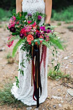 bouquet with ferns and cascading ribbons - photo by Amilia Photography http://ruffledblog.com/cheery-bohemian-wedding-inspiration-at-a-rock-quarry