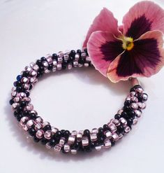 This Pink Onyx Kumihimo Bracelet is a bracelet that was designed using Pink and Onyx Czech Glass Seed Beads. Only at Magdalene Jewels on Etsy! Braided Bracelets, Handmade Bracelets, Handmade Jewelry, Handmade Items, Beaded Earrings, Beaded Jewelry, Drop Earrings, Silver Earrings, Armband Pink