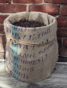 just a 5 gallon bucket wrapped in a burlap sack, then jute twine wrapped around it! what a CUTE planter!