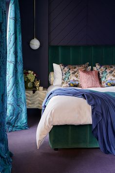 The Idea Home Show- Styled by Sophie Robinson. Dark and moody bedroom with colourful accessories. Green velvet bed.