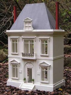 la bagatelle, cute small dollhouse with steep roof line and detail. If anyone knows a kit company that makes a house like this, please email me. Thanks, Rick Maccione www.dollhousemansions.com
