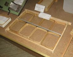 A frame containing wood sections for honey comb production/packaging.