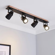 Featuring a bar with four spot lights, this contemporary ceiling fitting is finished with copper detailing and is dimmable for your convenience.Please note: Bulbs are not included. Kitchen Ceiling Spotlights, Bedroom Spotlights, Flat Ceiling Lights, Track Lighting Bedroom, Apartment Lighting, Garage Lighting, Salon Lighting, Flush Lighting, Interior Lighting