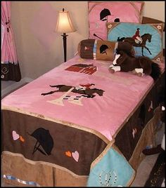 colorful girls bedding collection for the girl that loves horses, the Carstens English Bedding ensemble with transform any girls bedroom in to horse lovers retreat. This adorable bed set brings playful, horse riding style to your childs bedroom, in shades of pink, chocolate and caramel, with images of jumping horses, barn, horseshoes, stars and riding helmet. Available in Twin and Full sizes.