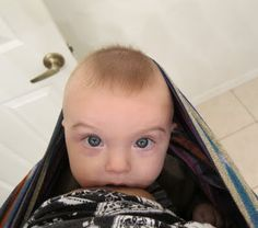 Breastfeeding baby in a sling. Cool perspective. #babywearing #bfcafe