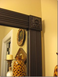 Framing a plain mirror with decorative corner- don't have to worry about that 45 degree cut!!
