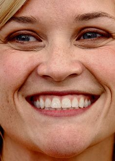 Close-up of Reese Witherspoon. I like this photo because it shows exactly how teeth photograph... with texture and color variation. When a photo editor takes a raw picture and begins to transform it into the typical image of a celebrity, teeth always get a color/whitening overhaul (and sometimes, they get straightened too).