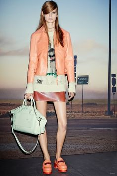 Coach Spring/Summer 2015--For his second collection for the brand, Coach's Stuart Vevers presented seventies inspired looks with unexpected pastels, shaggy