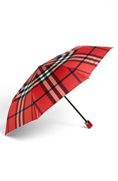 #3 The Umbrella | #levostyle http://www.levo.com/articles/fashion/how-to-dress-professionally-when-its-raining-outside-2 Red Burberry Umbrella