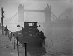 A tugboat on the Thames near Tower Bridge during The Great Smog in London, 1952