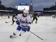 Montreal Canadiens' Tomas Plekanec (14) chases the puck behind Boston Bruins goalie Tuukka Rask (40) during the third period of the NHL Winter Classic hockey game at Gillette Stadium in Foxborough, Mass., Friday, Jan. 1, 2016. The Canadiens won 5-1.