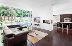 fraser-residence-minimal-palette-dark-oak-floors-cabinetry-contrast-white-surfaces-03