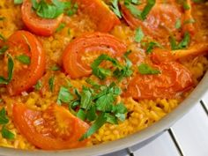 spanish paella. this looks soo good to me, and I have no idea what it even is besides Spanish rice...