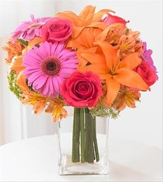 What a perfect summer day bouquet! Glorious orange lilies with hot pink roses and Gerbera daisies are arranged in a clear glass vase.  A splendid birthday or anniversary greeting, or  a gift for any occasion.