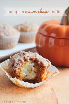 Pumpkin Cream Cheese Muffins! These beauties have a pumpkin muffin base, a cream cheese filling and a cinnamon streusel on top! YUM!