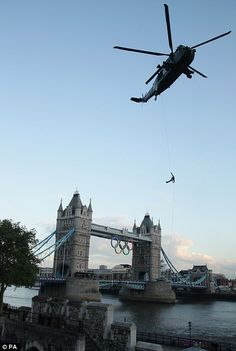 Sky high: The flame came down from the skies and was delivered to the eagerly awaiting crowd