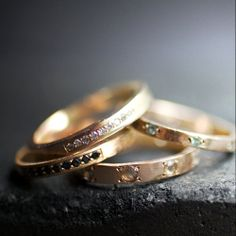 Love: wedding bands studded with colored gems.