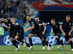Croatia beat Russia by a 4-3 win to enter semi-finals on 07/07/2018. Croatia players celebrate winning the penalty shootout. (Reuters Photo)