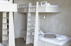Bunk beds with built-in closet. I like the wall treatment as well.