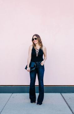 how to wear a lace up bodysuit and flare jeans