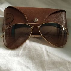Ray Ban Aviators Authentic Ray Ban Aviators, gold rimmed. Perfect condition! Comes with everything in the third picture. Ray-Ban Accessories Sunglasses