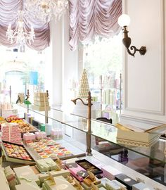Laduree Paris Patisserie Shop - lovely soft pastel coloured packing to complement the array of macaroons.
