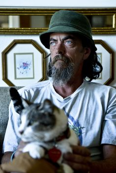"""Homeless man saves lost Oregon cat, will return her to owners after 10-month journey together.  """"Depression is a big thing out there.  The cat was a rainbow in a dark world."""""""