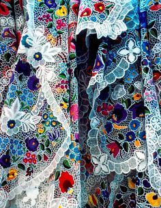 During the long, cold winters on the Great Plains in Hungary, the local people amuse themselves with creating colourful folkart. This kind of embroidered lace is typical of the Kalocsa region. Embroidery by dawekato