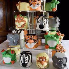 Cute!!! http://www.google.com/search?tbm=isch&source=mog&hl=en&gl=us&client=safari&tab=wi&q=birthday%20zoo%20cakes&sa=N&biw=320&bih=356#i=20