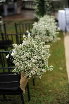 Arrangements of gypsophila were wrapped in burlap cones, and dressed up the aisle for the ceremony.